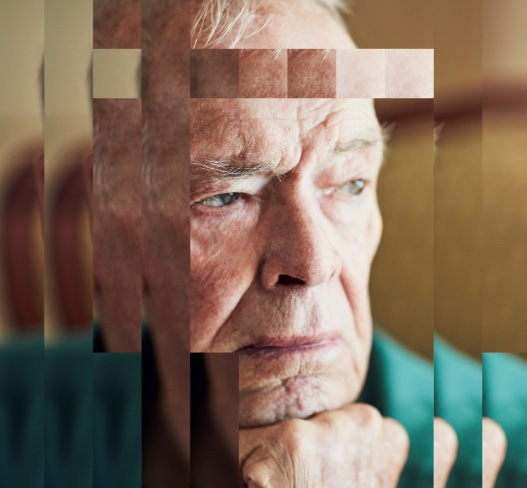 Elderly man looking contemplative